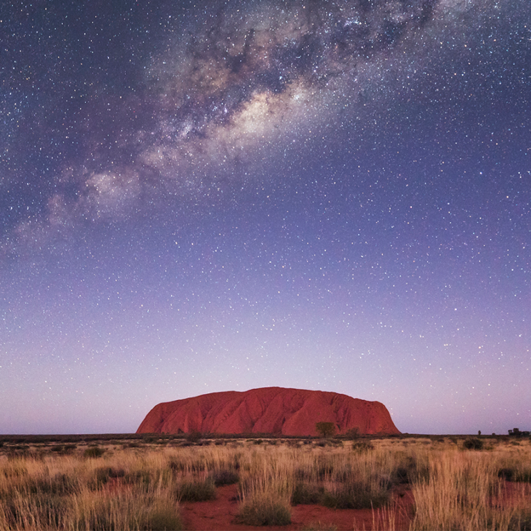Uluru rock in Australia under milky way